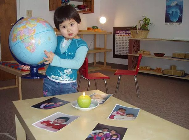 child learning geography at preschool