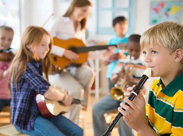 child playing music at preschool