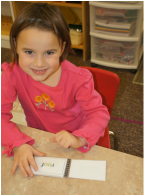 emily writing at preschool