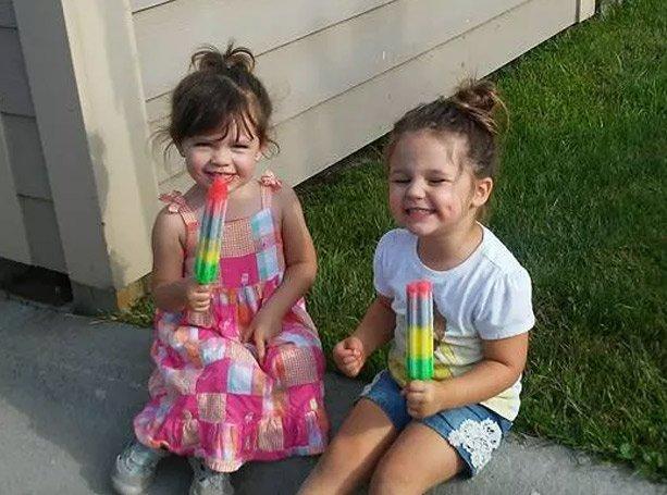 girls eating popsicles outside at preschool