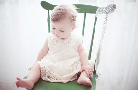 infant sitting in chair