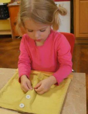 preschooler fixing shirt