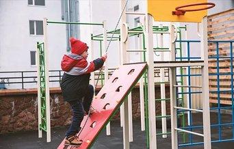 preschooler on playground