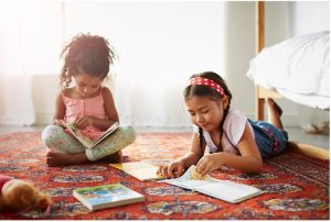 two girls reading at preschool